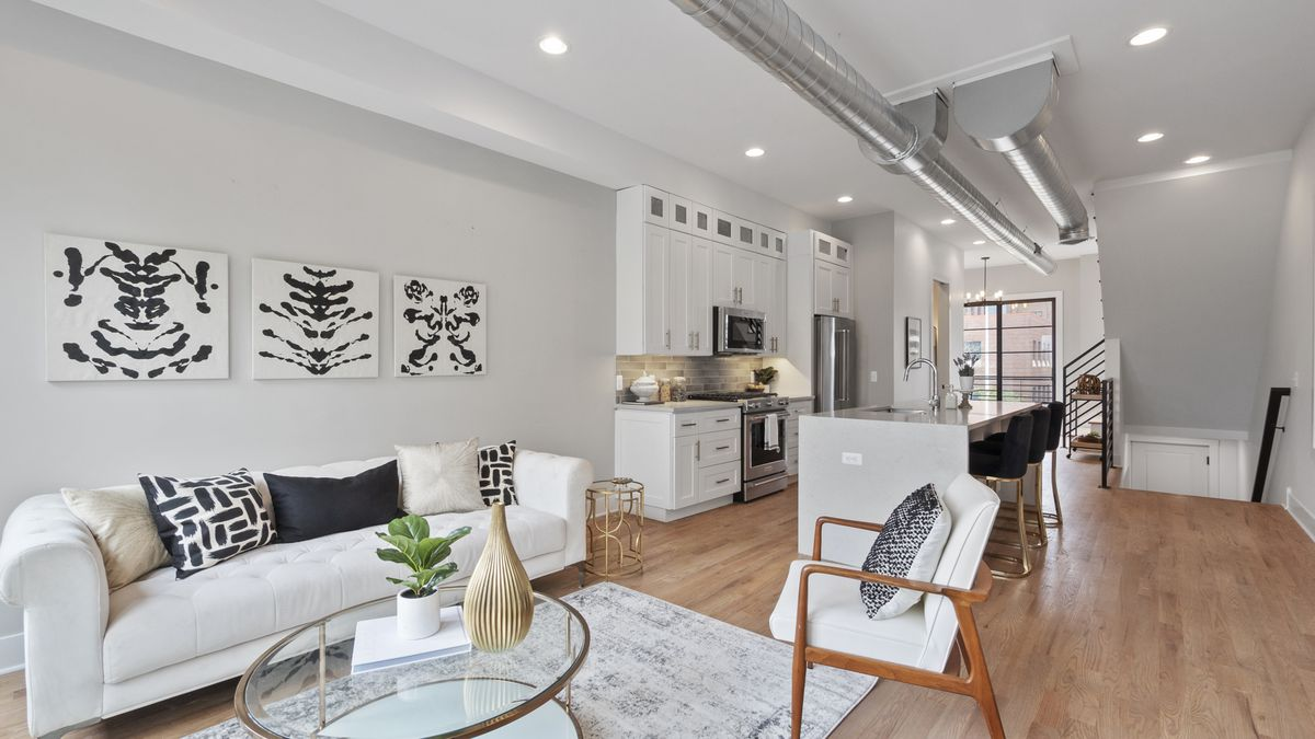 Open floor plan connects the living room to kitchen at James Place Lofts