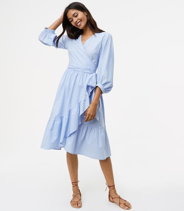 model in wrap dress with ruffles
