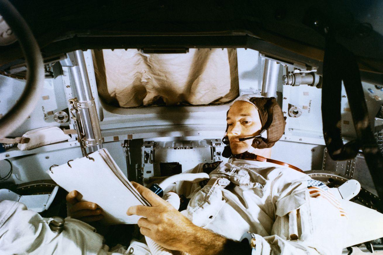 Michael Collins Studying Flight Plans