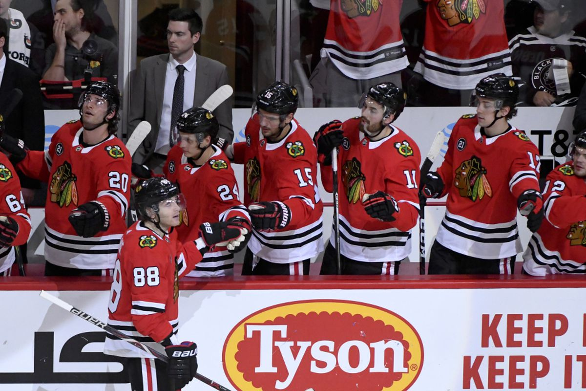 c7f6d933c05 Chicago Blackhawks right wing Patrick Kane (88) celebrates with teammates  after his goal during the third period of an NHL hockey game against the  Dallas ...