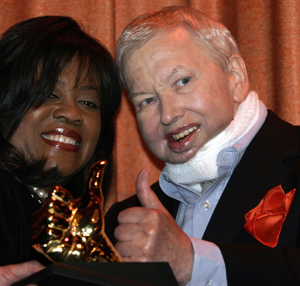 In his first public appearance since undergoing cancer-related surgery, Roger Ebert joins wife Chaz in displaying the Golden Thumb Award at his annual Overlooked Film Festival in 2007. | Seth Perlman/AP