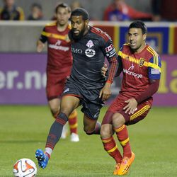 Toronto FC defender Jeremy Hall (25) steals the ball from Real Salt Lake midfielder Javier Morales (11) during a game at Rio Tinto Stadium in Sandy on Saturday, March 29, 2014.