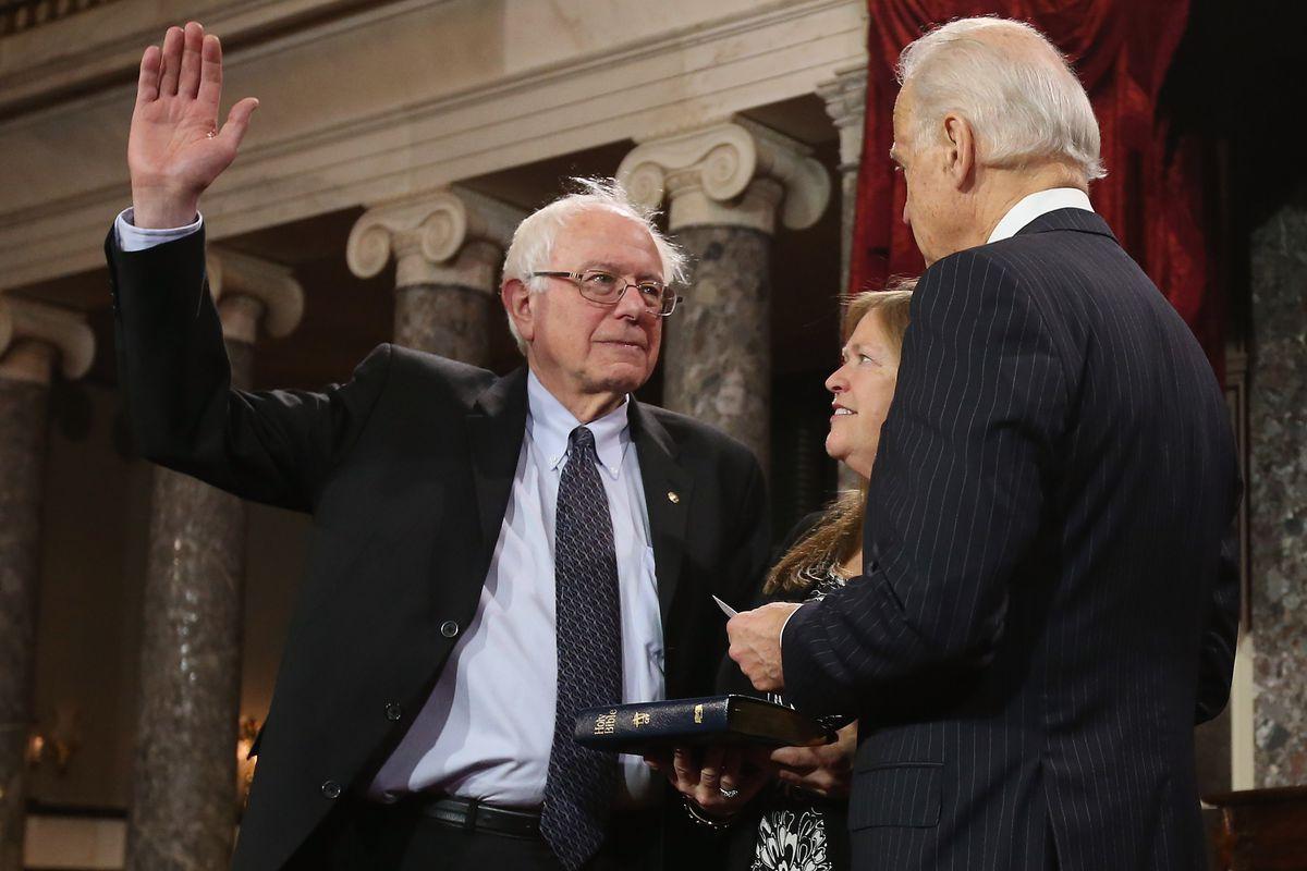 Then-Vice President Joe Biden swears in Sen. Bernie Sanders at the US Senate in January 2013.