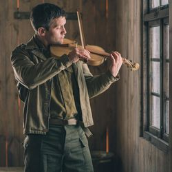 """Jack Ashton acts as Clair Cline playing a violin he made as a prisoner of war in northern Germany during World War II, as illustrated in BYUtv's """"Instrument of War."""""""