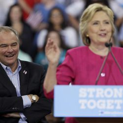 Democratic vice presidential candidate, Sen. Tim Kaine, D-Va. reacts as Democratic presidential candidate Hillary Clinton speaks during a campaign at Temple University, Friday, July 29, 2016, in Philadelphia.