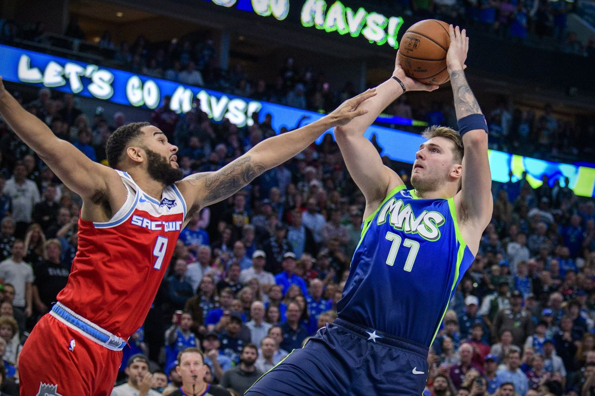 Dallas Mavericks forward Luka Doncic misses his final shot to tie the game as Sacramento Kings guard Cory Joseph defends during the second half at the American Airlines Center.
