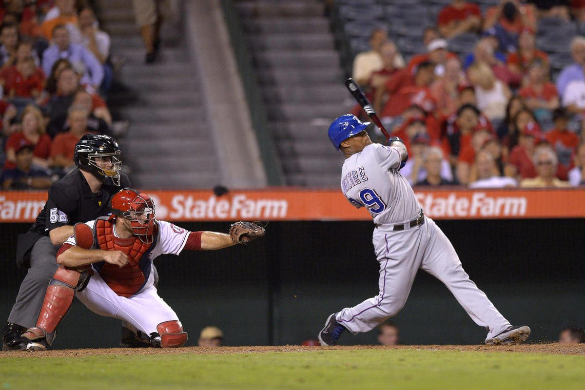 Texas Rangers' Adrian Beltre, right, hits a two-run home run as Los Angeles Angels catcher Chris Iannetta, center, and home plate umpire Bill Welke look on during the ninth inning of their baseball game against the Los Angeles Angels, Thursday, Sept. 20,