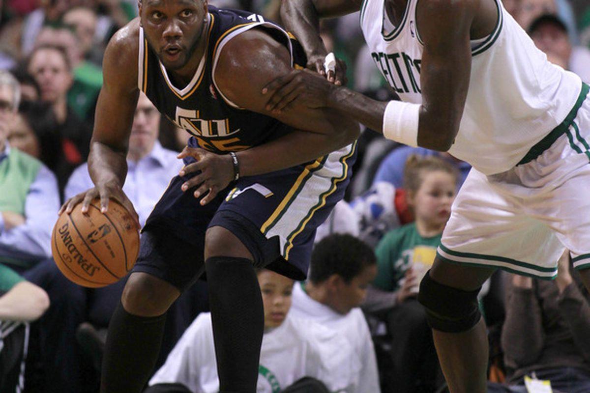 March 28, 2012; Boston, MA, USA; Utah Jazz forward/center Al Jefferson (25) is guarded by Boston Celtics forward/center Kevin Garnett (5) during the third quarter at TD Banknorth Garden.   Mandatory Credit: Greg M. Cooper-US PRESSWIRE