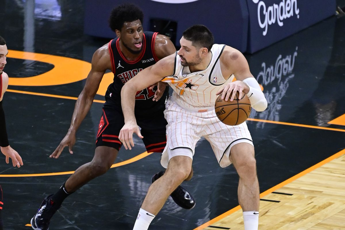 Nikola Vucevic of the Orlando Magic dribbles the ball with pressure from Thaddeus Young of the Chicago Bulls during the second quarter at Amway Center on February 05, 2021 in Orlando, Florida.