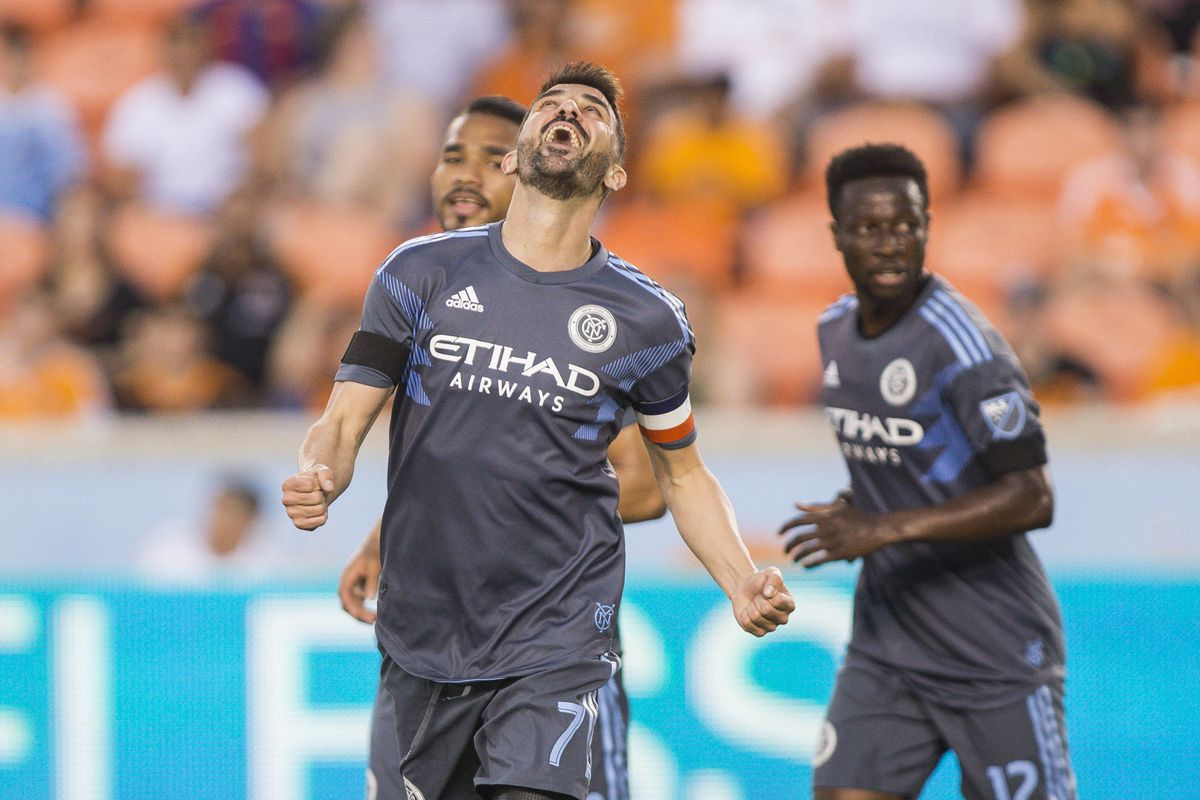 David Villa celebrates after scoring early in the game