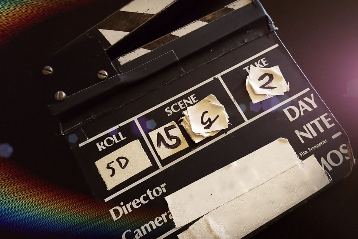 A clapboard hangs open with a light refraction