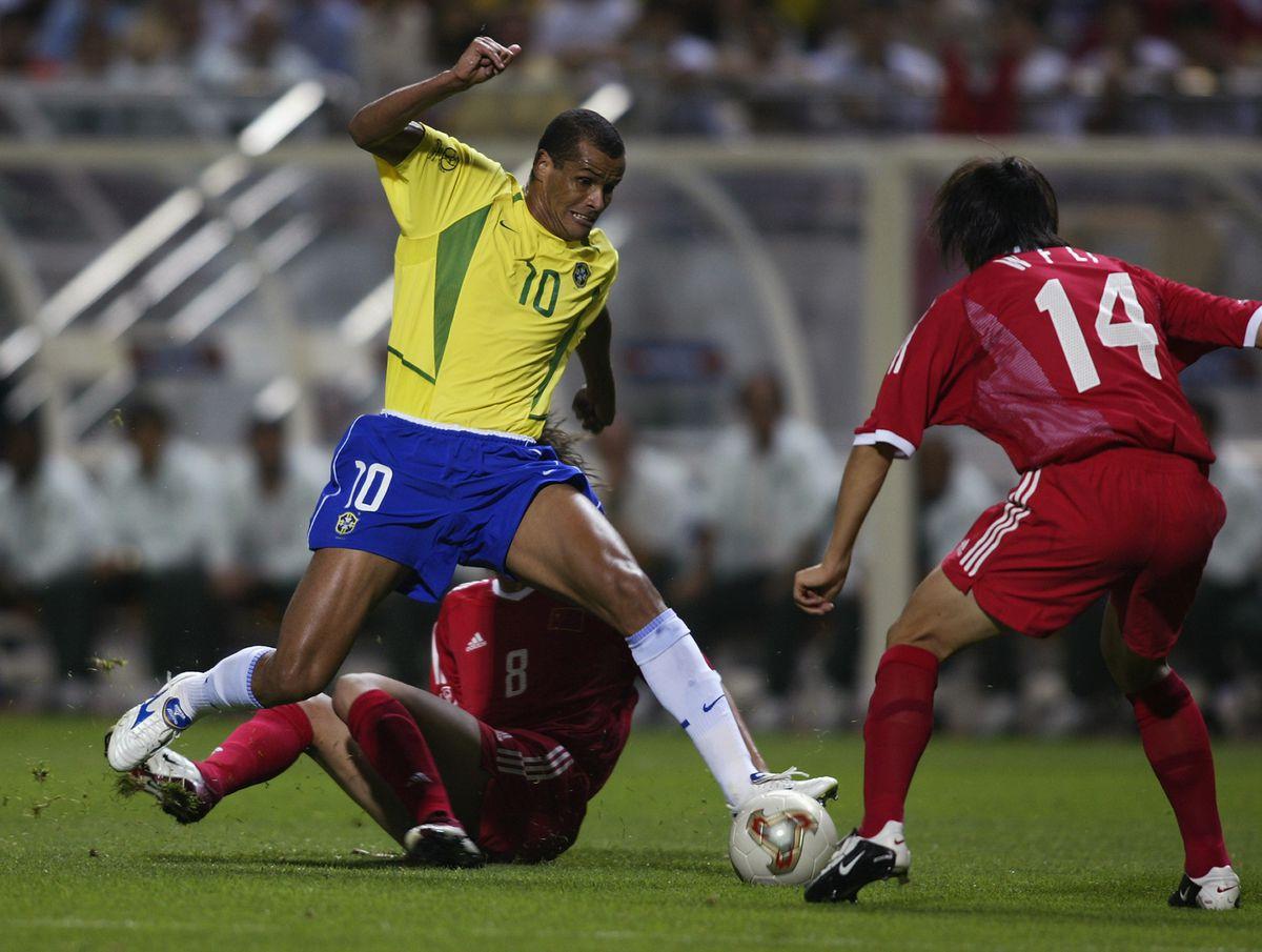 Rivaldo of Brazil and Tie Li and Weifeng Li of China
