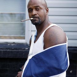 Deon Tucker, wears an arm sling while returning to his home in Tulsa, Okla., Monday, April 9, 2012. Tucker was injured in the shooting rampage Friday, that left three people dead and terrorized Tulsa's African-American community.