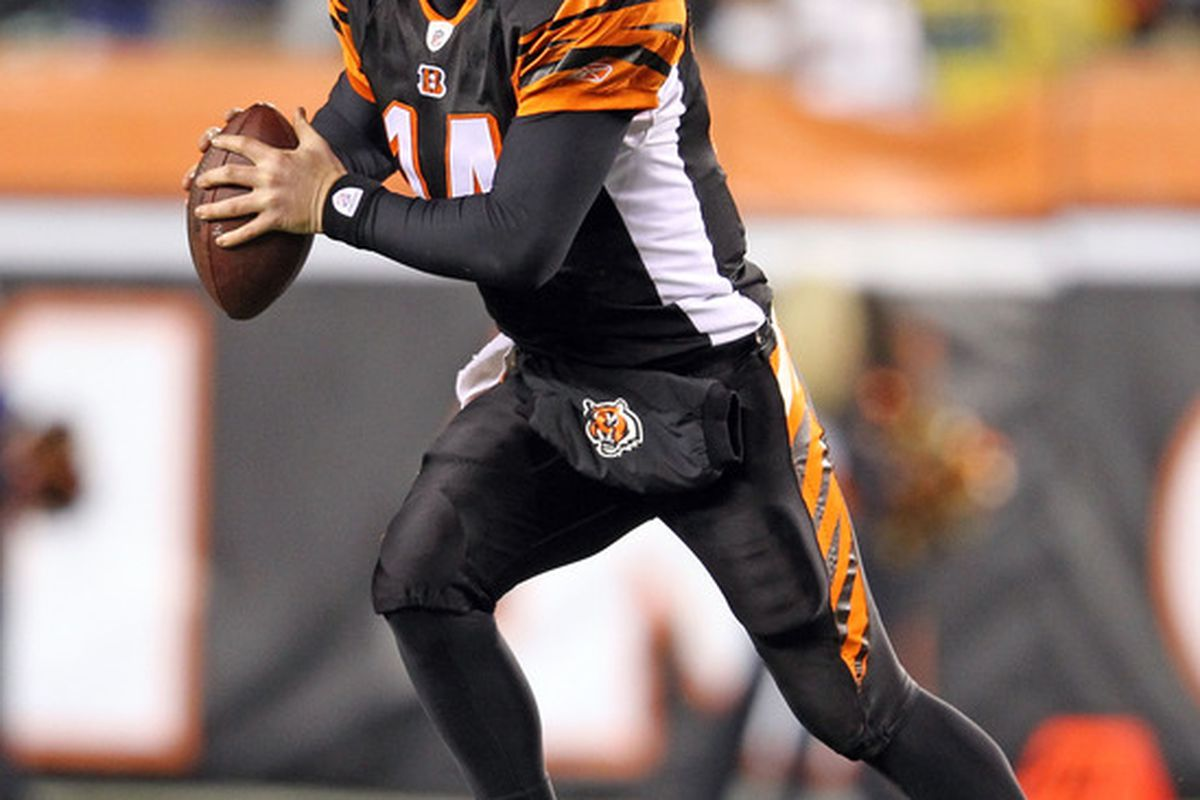 Andy Dalton #14 of the Cincinnati Bengals runs with the ball during the NFL game against the Baltimore Ravens at Paul Brown Stadium on January 1, 2012 in Cincinnati, Ohio.  (Photo by Andy Lyons/Getty Images)
