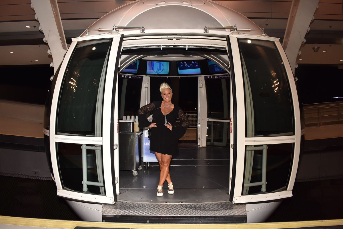 A woman stands with her legs crossed on one of the pods at the High Roller