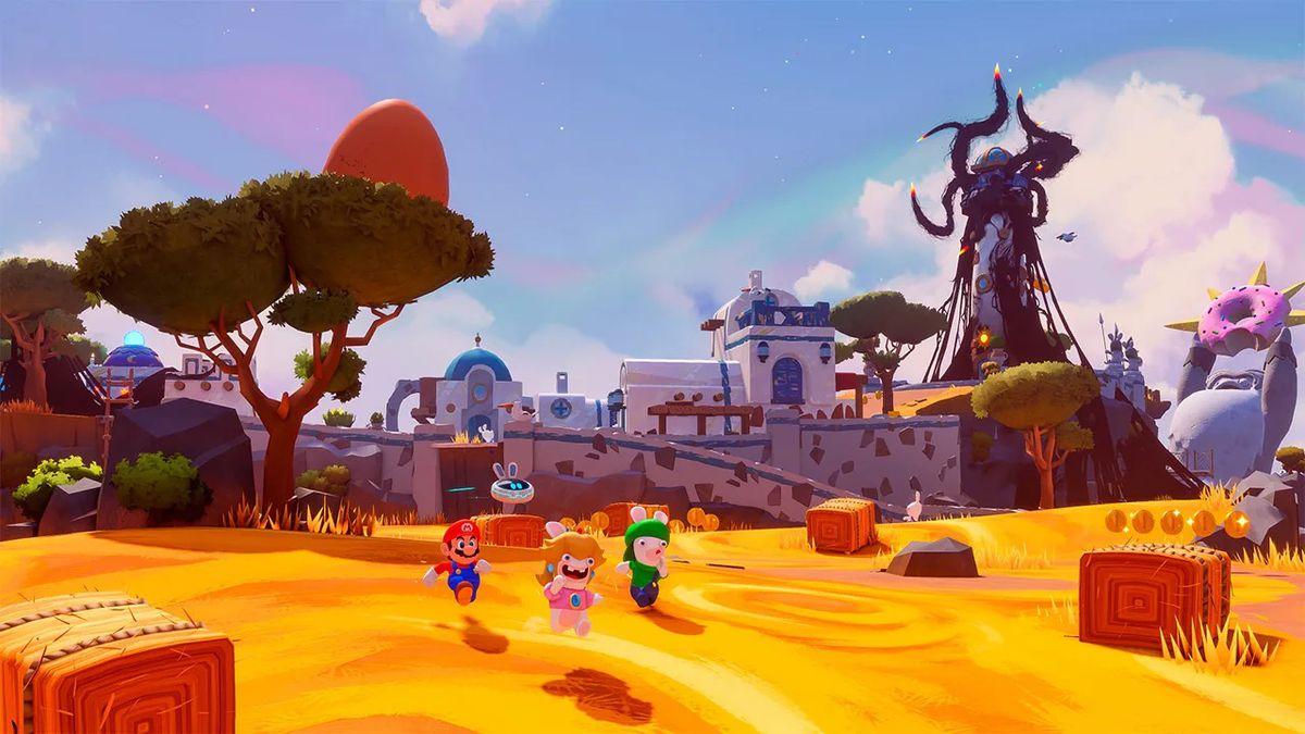 Rabbid Peach, Rabbid Luigi, dan Mario berlari melintasi ladang emas di Mario + Rabbids Sparks of Hope