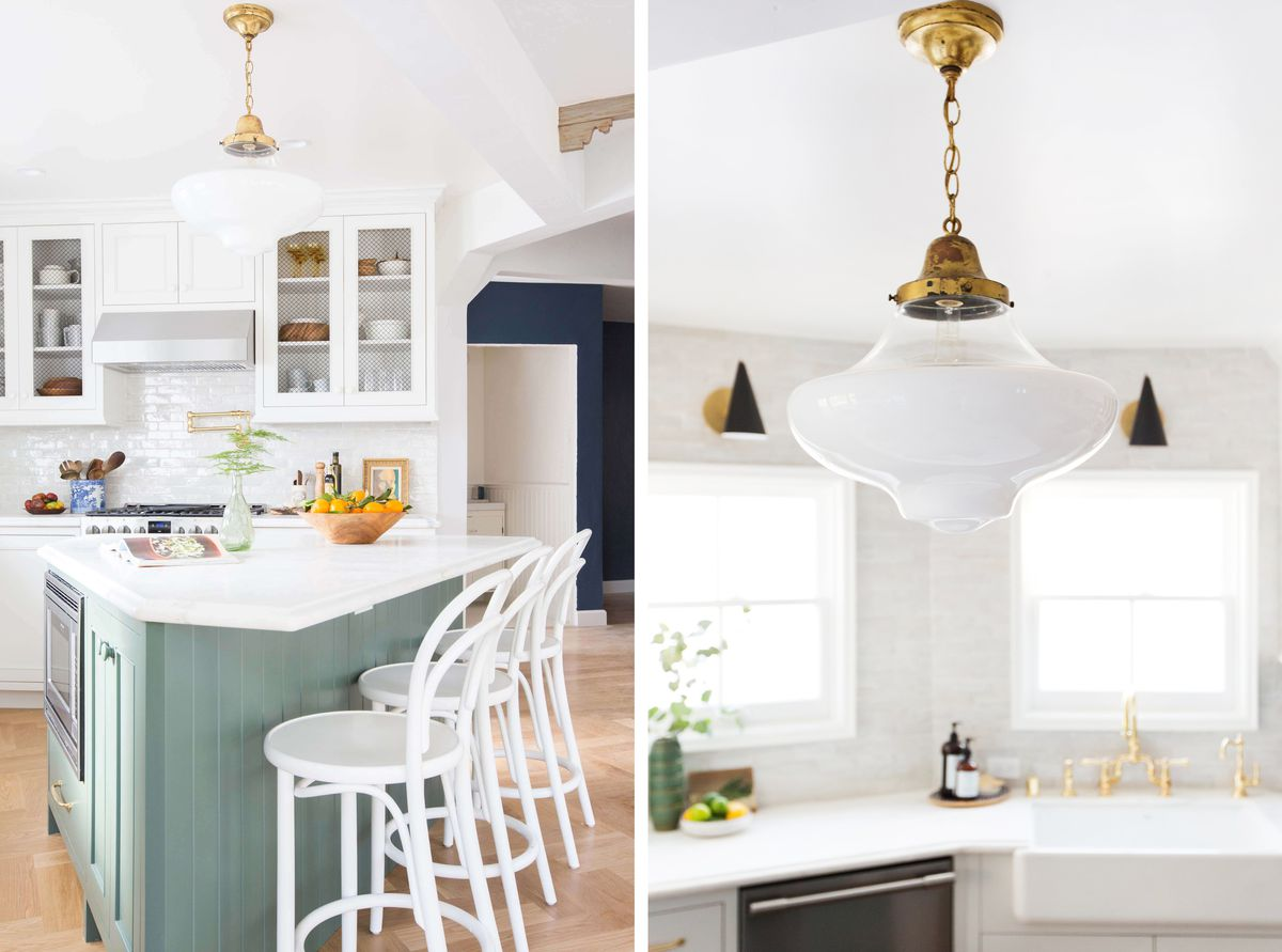 The island is an odd shape but works in their kitchen. The fixture above the island has brass detailing, so does the hardware on the sink.
