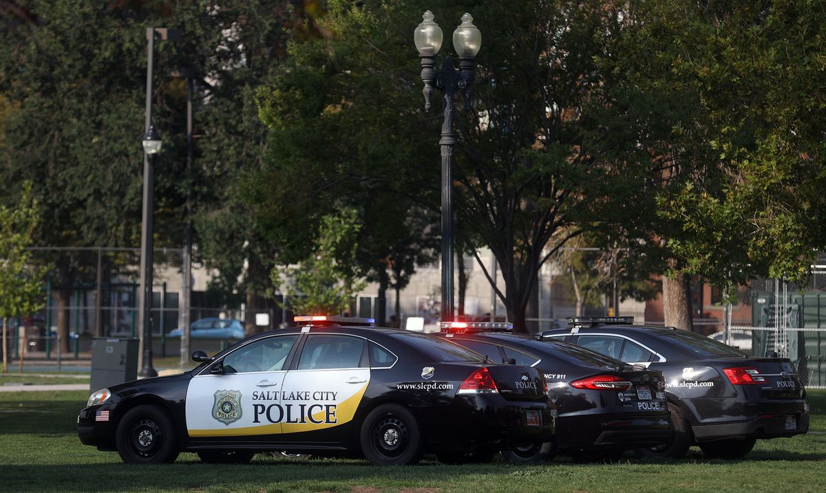 Police vehicles are parked at Pioneer Park during a press conference about the Salt Lake City's crime rates on Tuesday, Sept. 7, 2021.