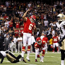 Kansas City Chiefs kicker Ryan Succop (6) celebrates his game-winning field goal as New Orleans Saints cornerback Patrick Robinson (21) falls to the turf in overtime of an NFL football game in New Orleans, Sunday, Sept. 23, 2012. The Chiefs won 27-24.