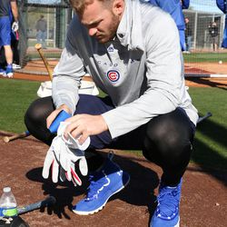 Ian Happ takes off his batting gloves after finishing batting practice on Field 1 at Riverview park, the Spring Training home of the Chicago Cubs, in Mesa, AZ.   John Antonoff/For the Sun-Times