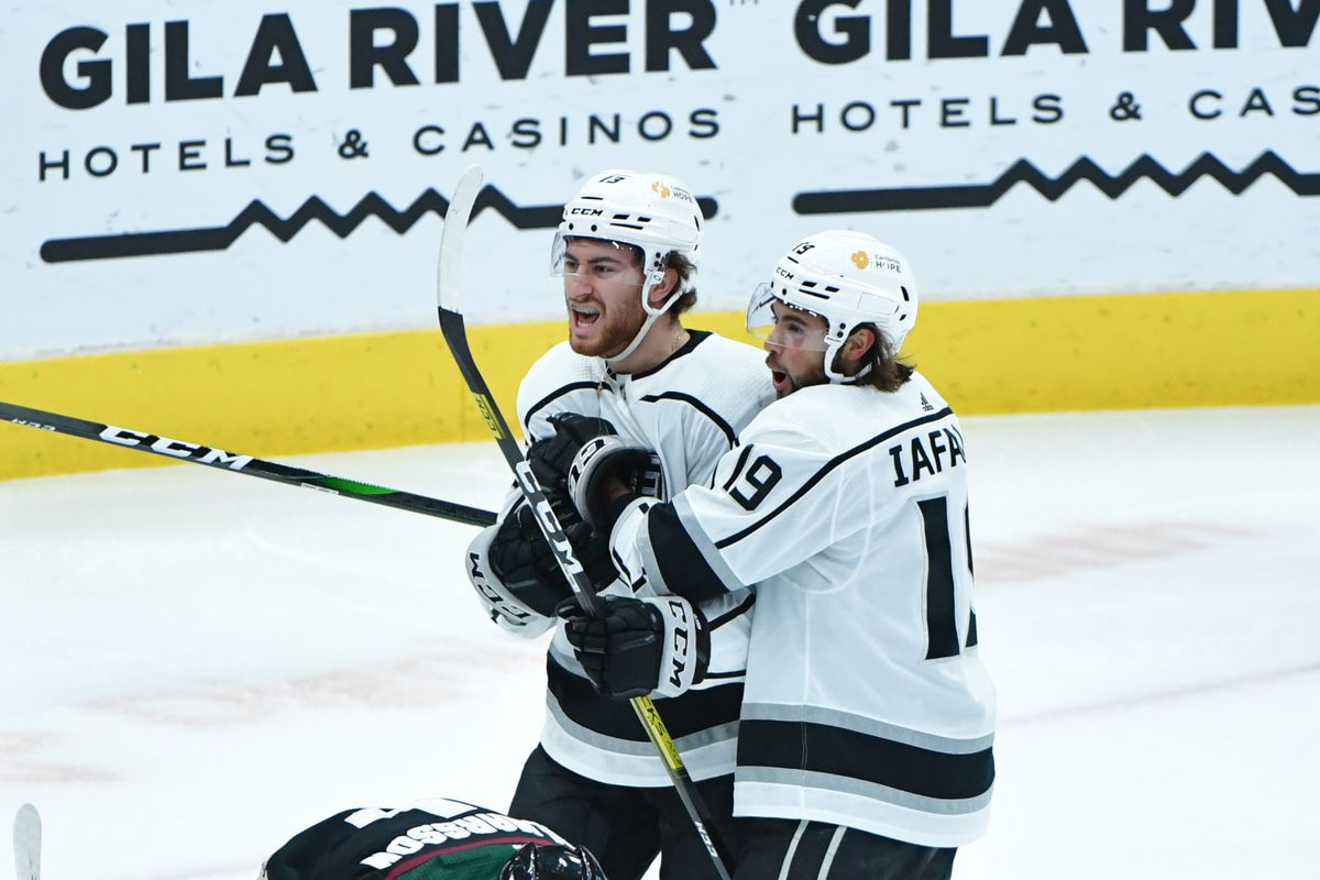 Los Angeles Kings center Gabriel Vilardi (13) celebrates with left wing Alex Iafallo (19) after scoring a goal in the third period against the Arizona Coyotes at Gila River Arena.