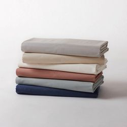 """<strong>Coyuchi</strong> Organic Cotton Percale, <a href=""""http://www.ahappyplanet.com/store/bedding/linens/organic_linens_per_coy.html"""">$195</a> for queen size at A Happy Planet"""