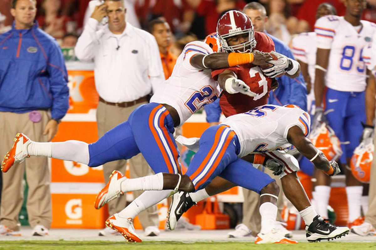TUSCALOOSA AL - OCTOBER 02:  Trent Richardson #3 of the Alabama Crimson Tide is tackled by Matt Elam #22 and Ahmad Black #35 of the Florida Gators at Bryant-Denny Stadium on October 2 2010 in Tuscaloosa Alabama.  (Photo by Kevin C. Cox/Getty Images)