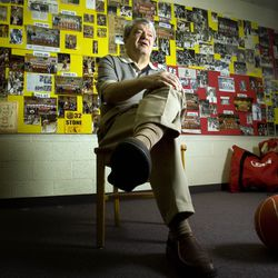 Coach Yerkovich sits in the team room surrounded by photos and news clippings of all his years of coaching. Judge Catholic High School boys basketball coach Jim Yerkovich is announcing his retirement on Tuesday after 44 years as a head coach. Monday, March 1, 2010. Photo by Scott G Winterton Deseret News.