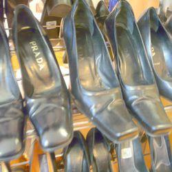 Lots of black Prada shoes, $75 a pair
