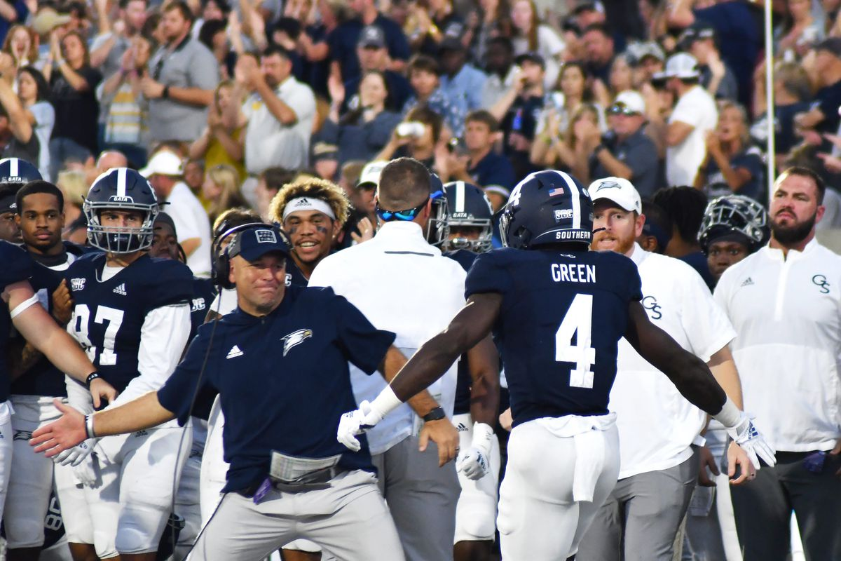 Georgia Southern head football coach Chad Lunsford welcomes running back Gerald Green back to the sideline after Green scores a rushing touchdown against visiting Louisiana Saturday night.
