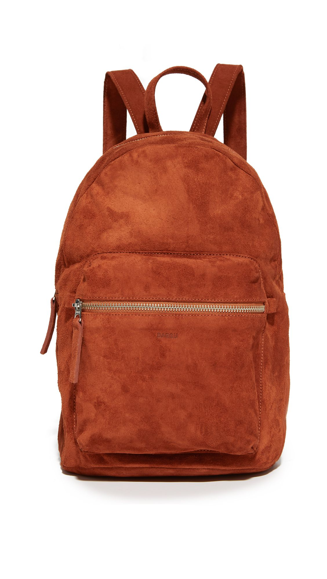 A rust colored suede backpack