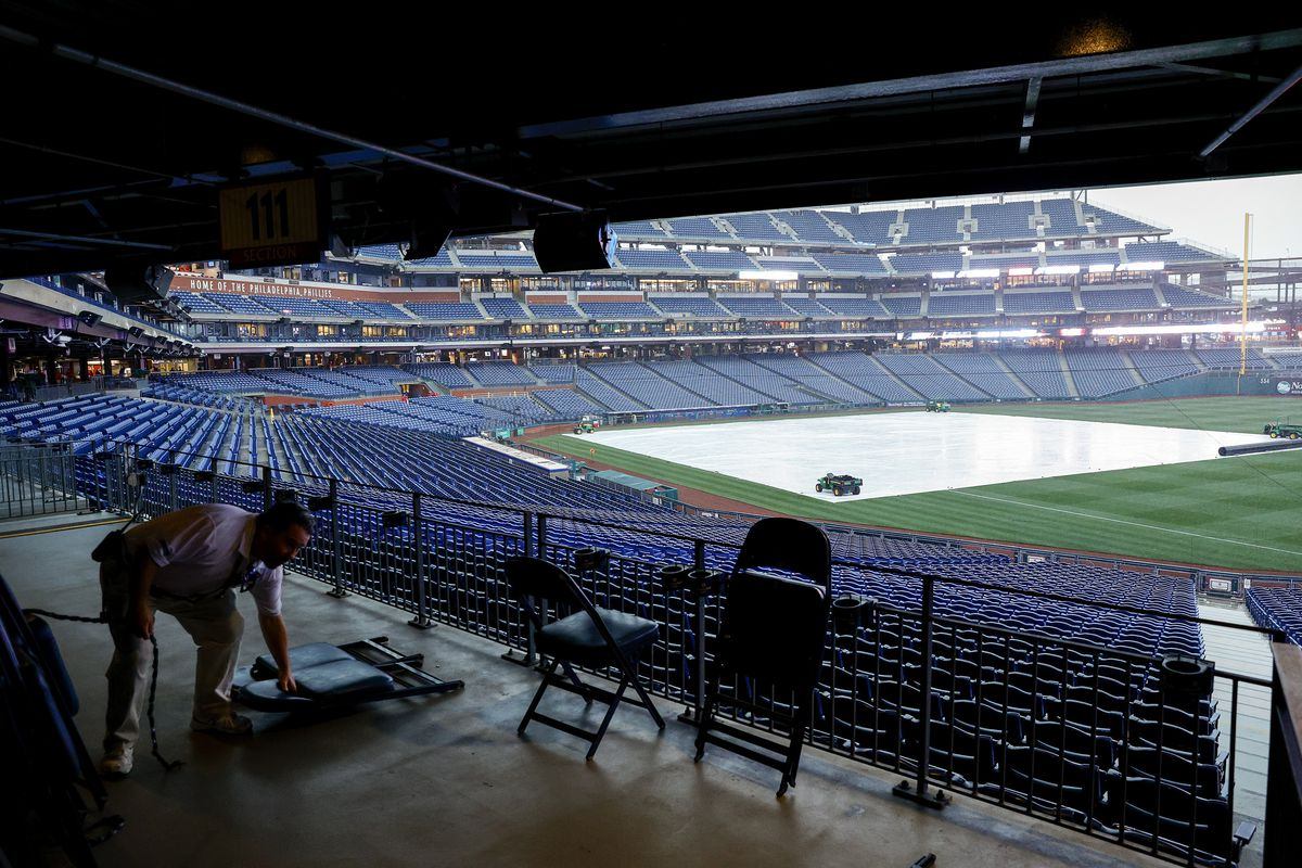 Chairs are put away before a rained out game between the Philadelphia Phillies and the Miami Marlins at Citizens Bank Park