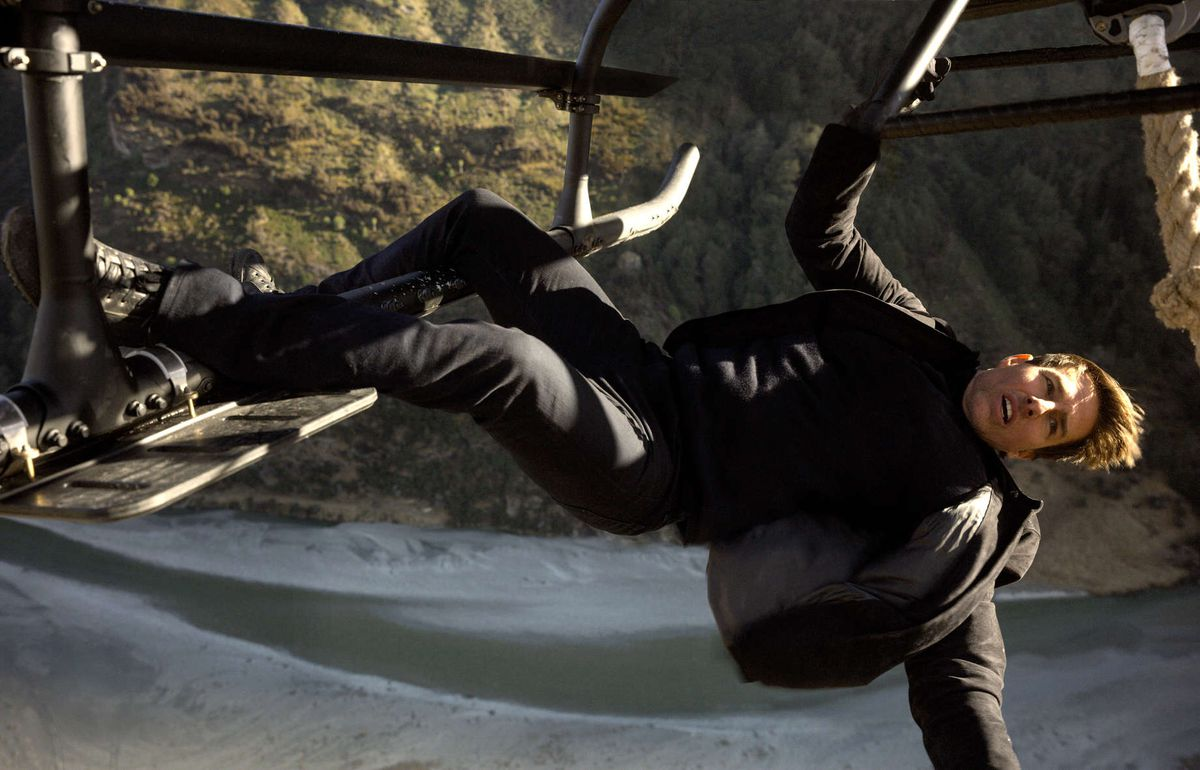 Tom Cruise hangs from a helicopter