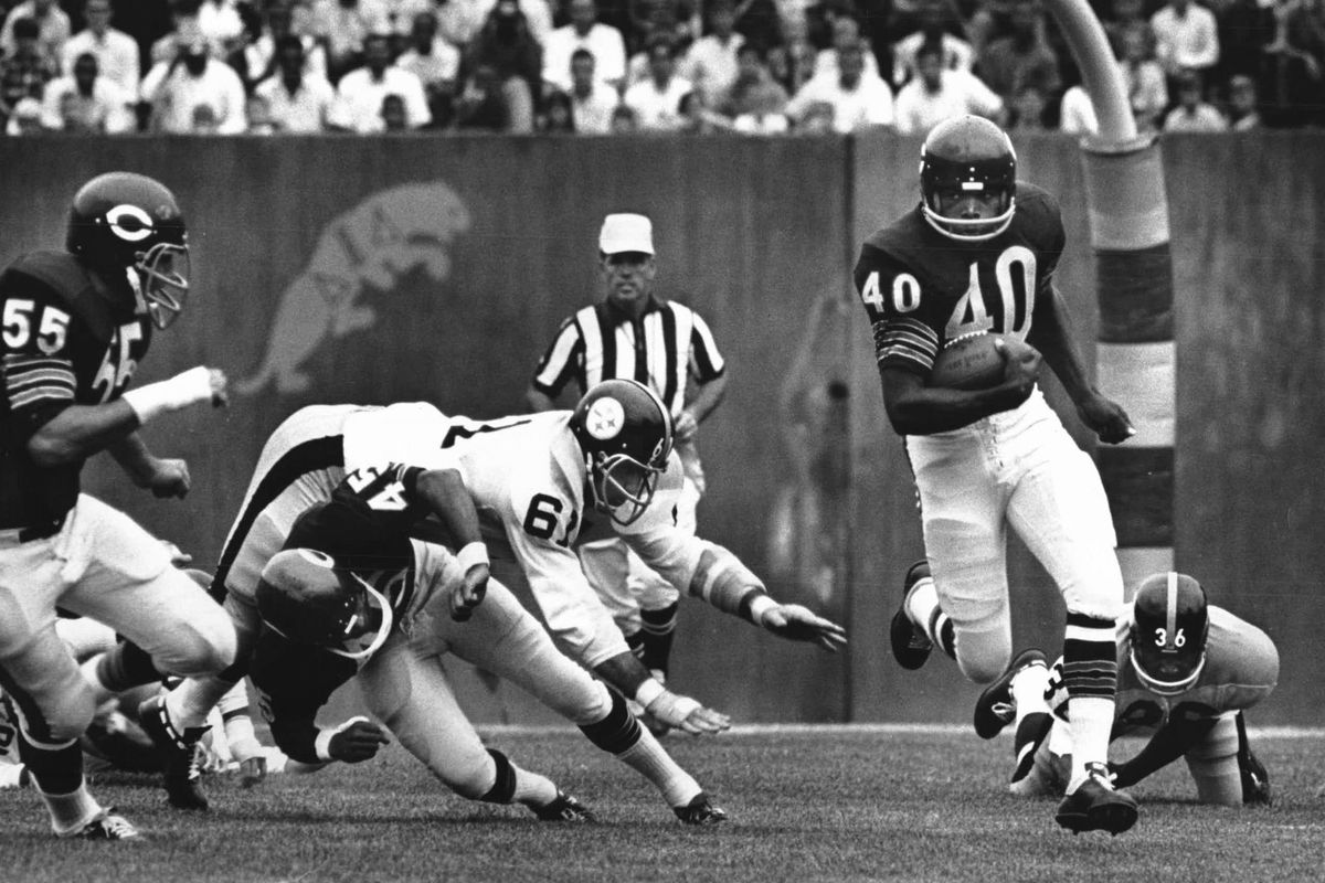 """""""People will say there were better players, but I don't know who they are,"""" former Bears coach Mike Ditka said of his former teammate Gale Sayers (40, scoring on a 103-yard kickoff return against the Steelers)."""