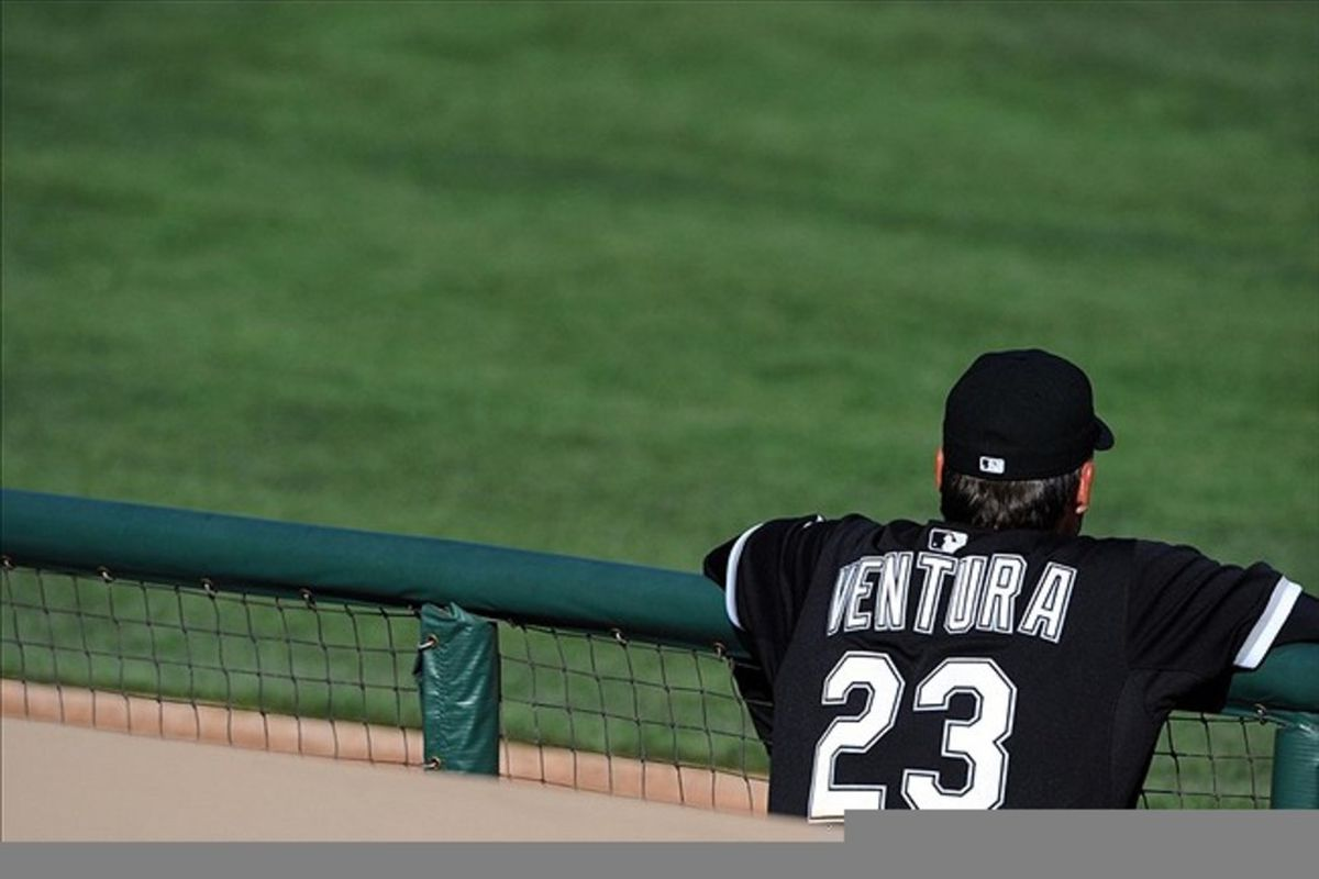 Chicago White Sox manager Robin Ventura (23) watches from the bench during the eighth inning against the Oakland Athletics at Camelback Ranch. Mandatory Credit: Christopher Hanewinckel-US PRESSWIRE