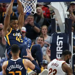 Utah Jazz guard Donovan Mitchell (45) dunks over Cleveland Cavaliers forward LeBron James (23) during the game at Vivint Arena in Salt Lake City on Saturday, Dec. 30, 2017.