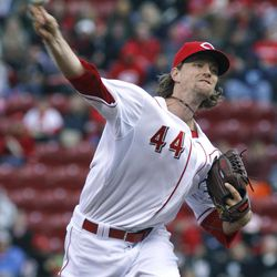 Cincinnati Reds  pitcher Mike Leake throws against the St. Louis Cardinals in the first inning of their baseball game in Cincinnati Tuesday April 10, 2012.