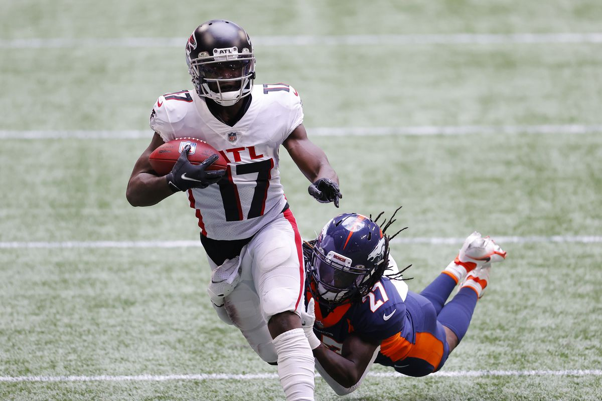 Davontae Harris #27 of the Denver Broncos attempts to tackle Olamide Zaccheaus #17 of the Atlanta Falcons during the first half at Mercedes-Benz Stadium on November 08, 2020 in Atlanta, Georgia.