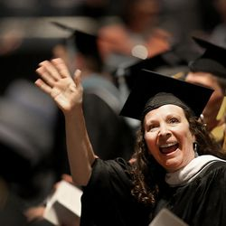 Mary Bonham waves to family before commencement exercises at Brigham Young University in Provo on Thursday, Aug. 13, 2015. Bonham received a master of linguistics degree.