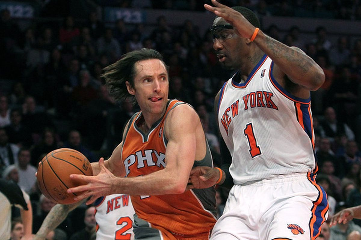 Steve Nash #13 of the Phoenix Suns drives to the basket against Amar'e Stoudemire #1 of the New York Knicks at Madison Square Garden on January 17 2011 in New York City. (Photo by Nick Laham/Getty Images)