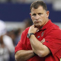 Tampa Bay Buccaneers head coach Greg Schiano watches his team warm up before an NFL football game against the Dallas Cowboys, Sunday, Sept. 23, 2012, in Arlington, Texas.