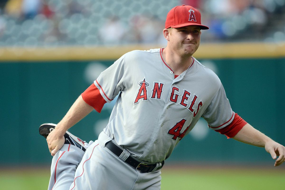 July 3, 2012; Cleveland, OH USA: Los Angeles Angels right fielder Mark Trumbo (44) stretches before the game against the Cleveland Indians at Progressive Field.  Mandatory Credit: Eric P. Mull-USPRESSWIRE