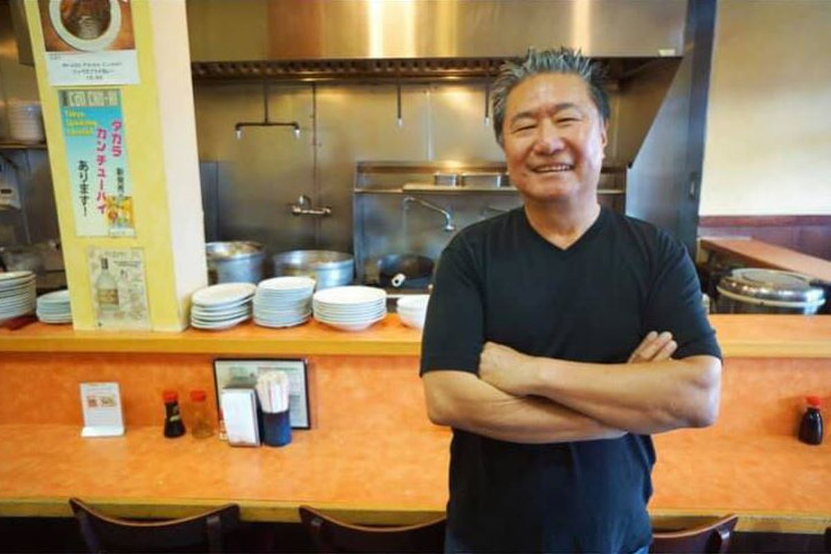 Hiroshi Yamauchi, owner of Kouraku restaurant in Little Tokyo, who died on September 22, 2020 stands in his restaurant with arms folded.