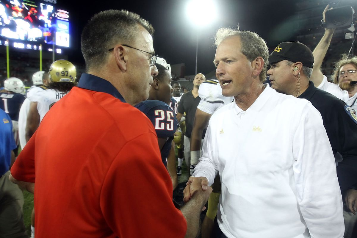 TUCSON, AZ - OCTOBER 20:  Head coach Rick Neuheisel of the UCLA Bruins needs to shake hands and get out of town. (Photo by Christian Petersen/Getty Images)