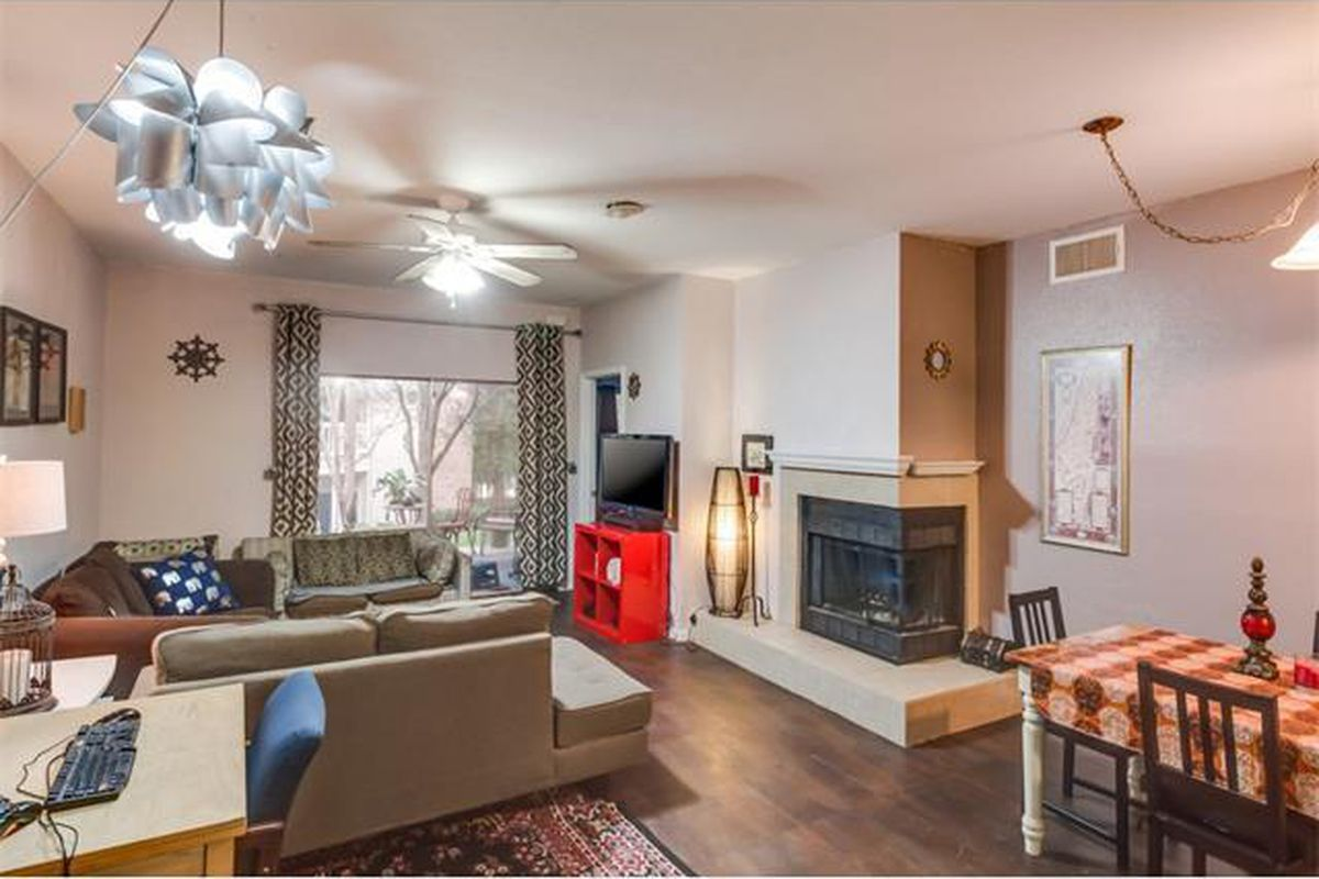 Condo living room with fireplace, sliding glass door, contemporary furniture