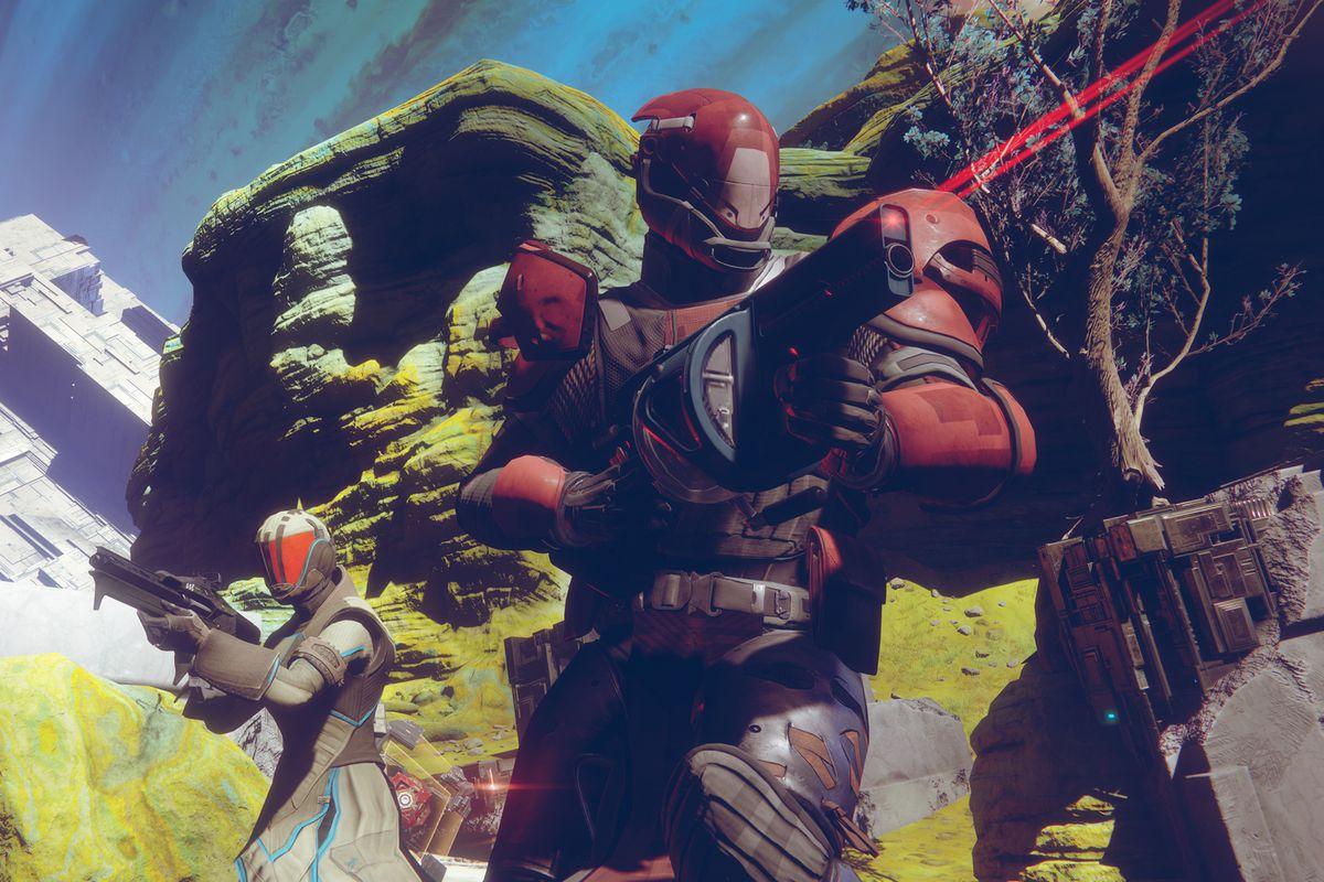 Destiny 2 - two Guardians firing guns on Io