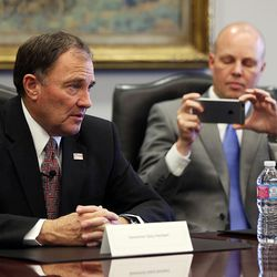 Campaign Manager Marty Carpenter takes photos of Gov. Gary Herbert as the governor meets with the Deseret Media Companies Editorial Board in Salt Lake City on Monday, May 23, 2016.