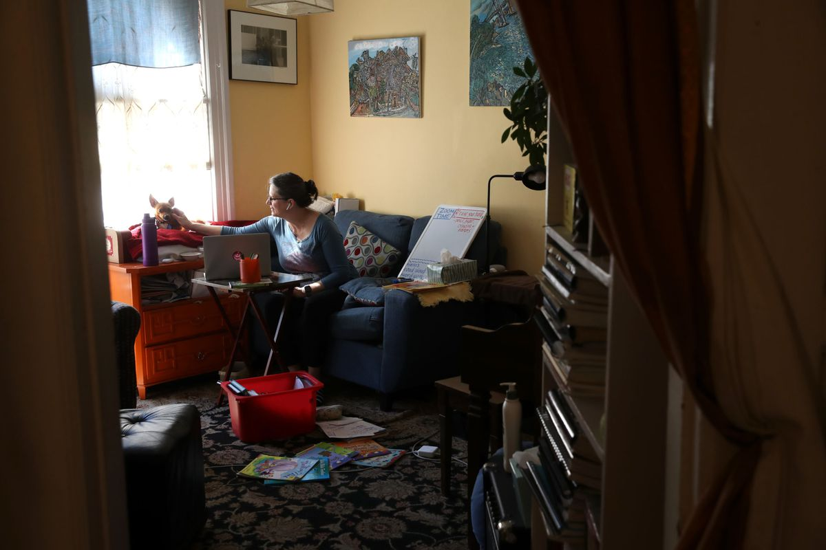 Leanne Francis, first grade teacher at Harvey Milk Civil Rights Academy, conducts an online class from her living room in San Francisco, California. With schools closed across the United States due to the COVID19 pandemic, teachers are holding some classes for students online.
