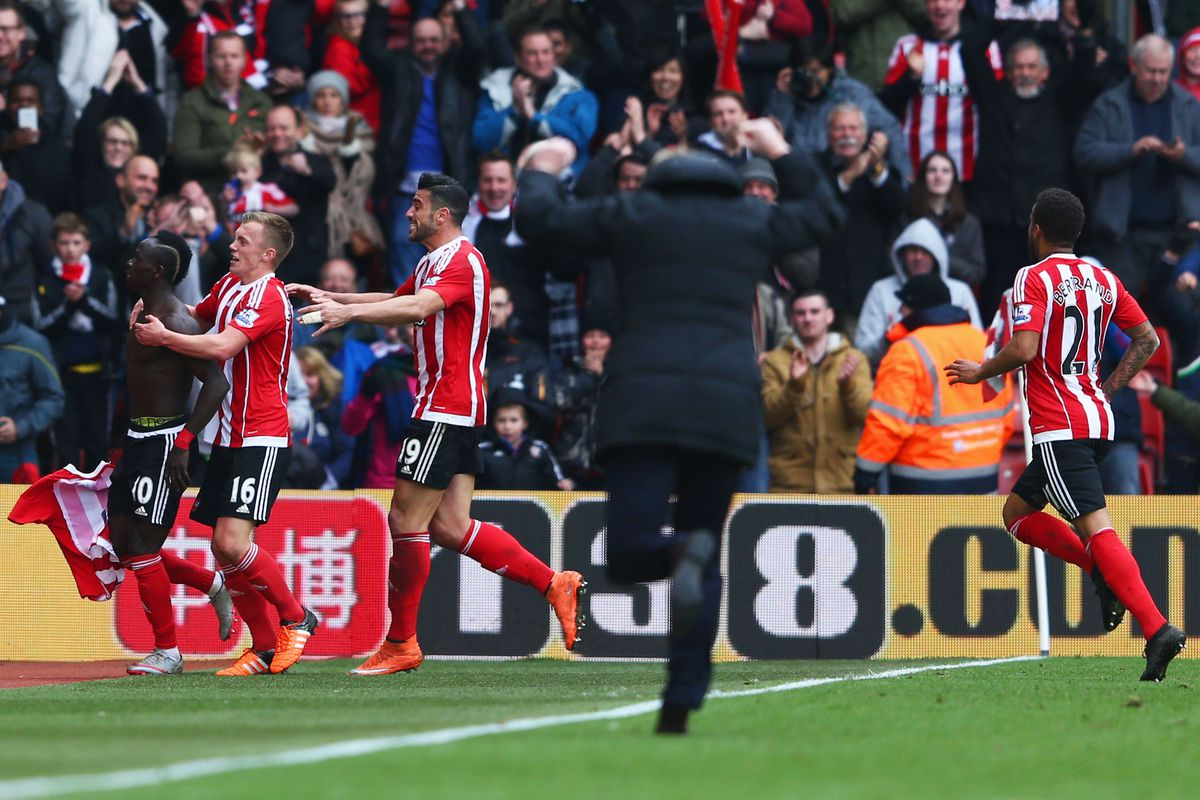 EUPHORIA: Ronald Koeman runs to join the players and celebrate the late winner with the Southampton fans