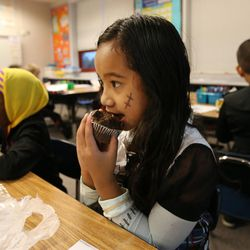 Jalye eats a muffin in Christie Duong's third-grade class during the Breakfast in the Classroom program at Backman Elementary School in Salt Lake City on Friday, Oct. 28, 2016.